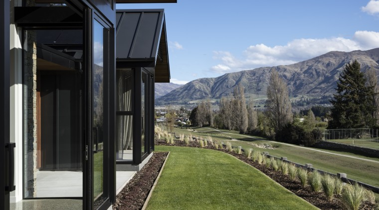 ​​​​​​​On this home by Condon Scott Architects, the alps, architecture, home, house, landscape, landscaping, lawn, mountain, mountain range, Condon Scott Architects