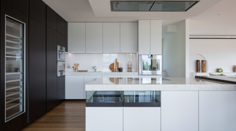 ​​​​​​​A glass splashback reflects light through this kitchen architecture, cabinetry, ceasarstone, countertop, benctop, cupboards, floor, flooring, timber, kitchen, Akzente, Poggenpohl, Lara Farmilo
