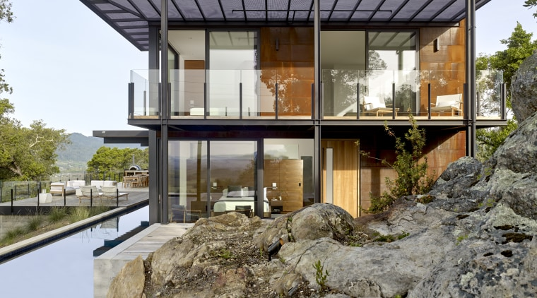 At one end of this home by architect architecture, building, design, home, house, roof, pool, exterior, de Vito Architecture + construction,  Jim Zack