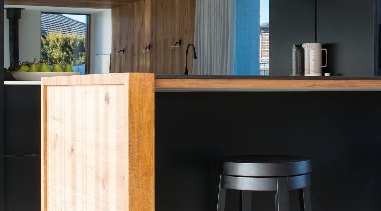 Mirror splashbacks add to the sense of space architecture, bar stool, kitchen, timber, glass splashback, stool, table, wood, wood stain, black, impact kitchens