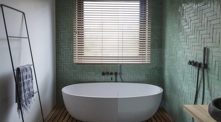 This bathroom's wet area containing the bath tub architecture, bathroom, bathtub, floor, flooring, home, house, interior design, plumbing fixture, tile, gray, black, Cantero Architecture