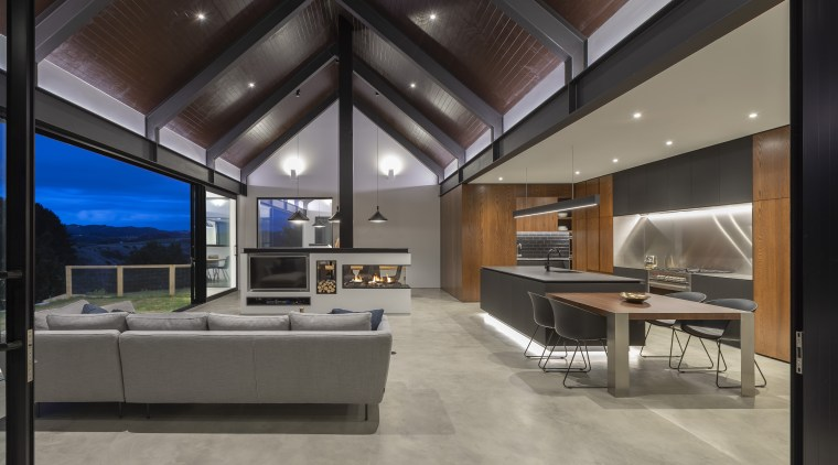 A lowered ceiling helps define this kitchen in apartment, architecture, building, ceiling, daylighting, design, floor, flooring, furniture, glass, home, house, interior design, lighting, living room, loft, office, property, real estate, room, table, wall, window, gray, black