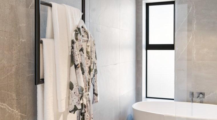 Hang 'em high! Ceiling hung towel rails provide architecture, bathroom, bathtub, ceramic tiles, floor, flooring, house, interior design, plumbing fixture, taps, tiles, wall, towel rail