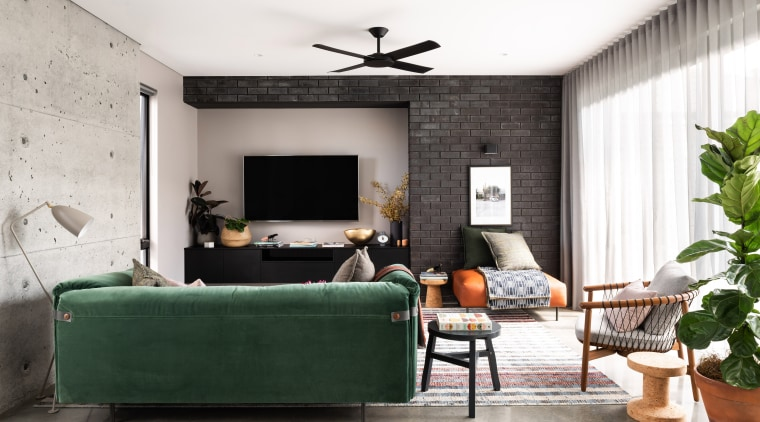 A feature cast-in-situ concrete wall with all imperfections architecture, building, ceiling, coffee table, comfort, couch, design, floor, flooring, furniture, green, home, house, interior design, living room, loft, property, room, table, wall, wallpaper, white, heat sink, heating, passive heating