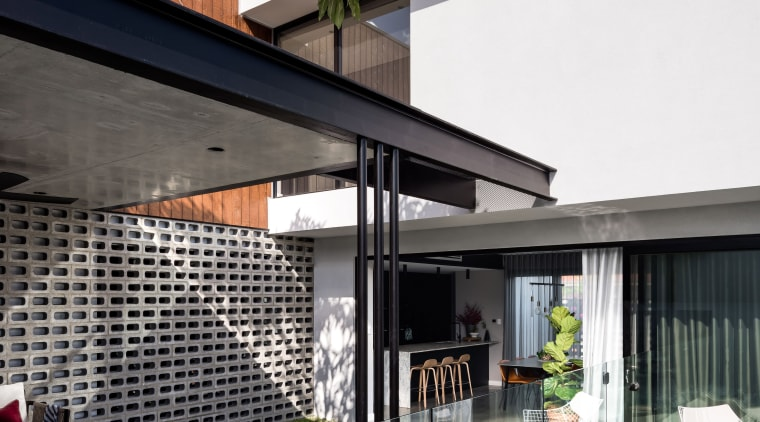 On this green-focussed home, pulling the covered alfresco architecture, backyard, courtyard, design, facade, furniture, home, house, interior design, patio, shade, alfresco dining