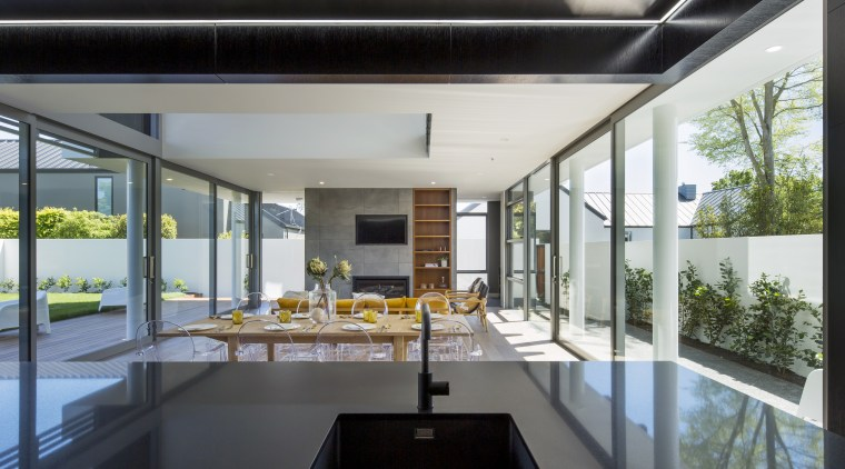 Easy to prep and cook in, with a apartment, architecture, building, ceiling, daylighting, design, facade, floor, furniture, home, house, interior design, living room, loft, material property, property, real estate, residential area, roof, room, window, gray, black