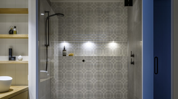 With its bold pattern tiling, black fittings and architecture, bathroom, building, ceiling, daylighting, floor, flooring, glass, home, house, interior design, plumbing fixture, property, room, tile, wall, gray