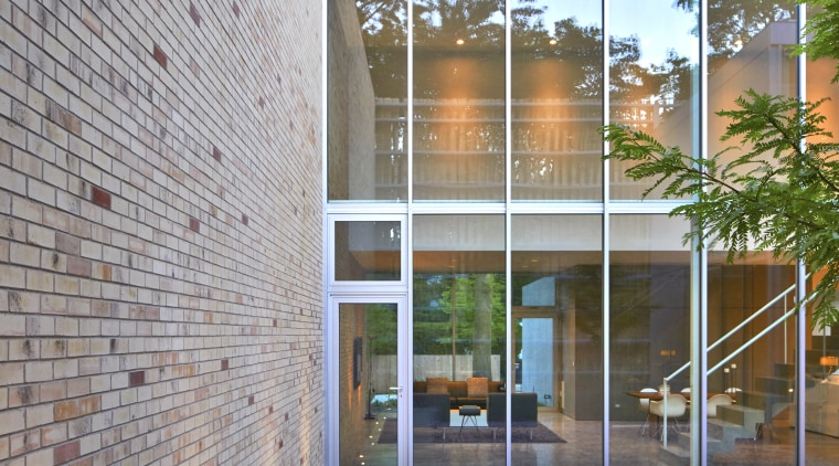 Outside in – the brick side wall runs architecture, brick, building, courtyard, daylighting, daytime, facade, home, house, interior design, line, property, real estate, residential area, stairs, wall, gray