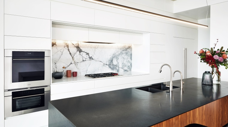 With this kitchen's perimeter cabinetry in white, the building, cabinetry, ceiling, countertop, floor, flooring, furniture, home, home appliance, house, interior design, kitchen, kitchen appliance, kitchen stove, material property, property, room, small appliance, table, tile, white