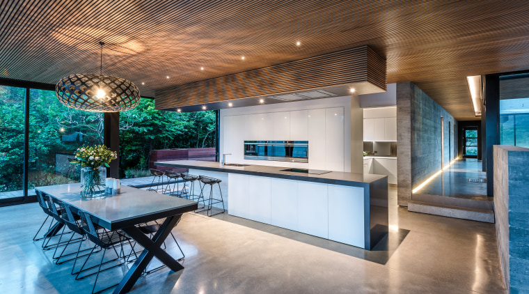 ​​​​​​​This kitchen is the hub of the home architecture, building, ceiling, countertop, design, estate, floor, flooring, furniture, home, house, interior design, kitchen, lighting, loft, property, real estate, room, table, gray