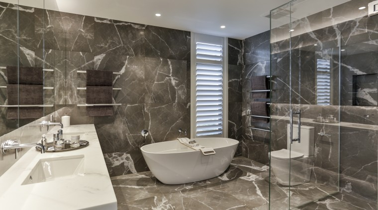 Large format porcelain tiles in a luxurious veined architecture, bathroom, bathtub, black-and-white, building, ceiling, floor, flooring, home, house, interior design, marble, plumbing fixture, property, real estate, room, tile, wall, gray