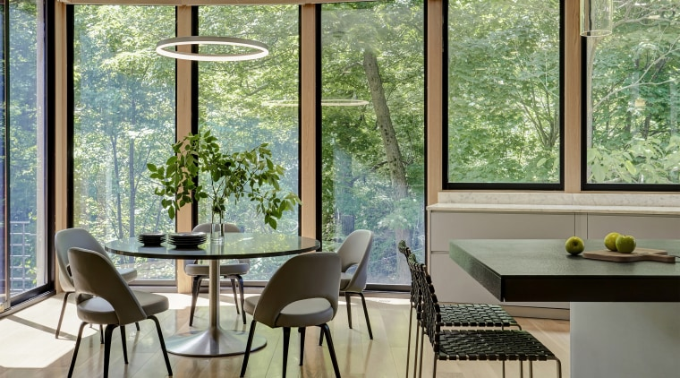 A curved wall of windows in this original architecture, building, ceiling, chair, daylighting, dining room, door, floor, furniture, glass, hardwood, home, house, interior design, property, room, shade, table, window, gray