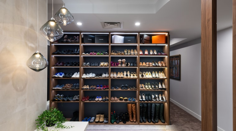 ​​​​​​​Shoe wardrobe one side, master bedroom headboard the architecture, building, display case, footwear, furniture, interior design, property, room, shelf, shelving, shoe, wine rack, gray