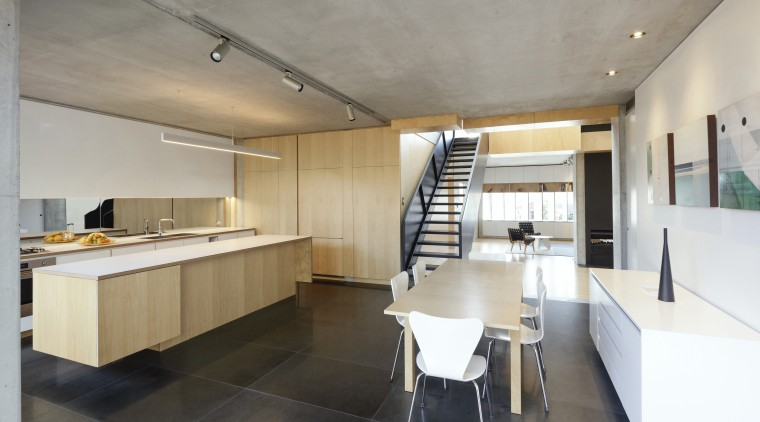 This kitchen by architect David Haseler has everything apartment, architecture, building, cabinetry, ceiling, countertop, design, floor, flooring, furniture, home, house, interior design, kitchen, loft, property, real estate, room, table, tile, wall, gray