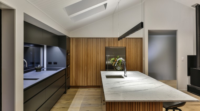 The 3D nature of the staved tall cabinet gray