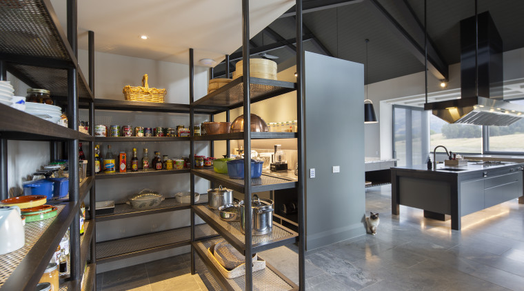 This kitchen's pantries are tucked out of sight gray, black