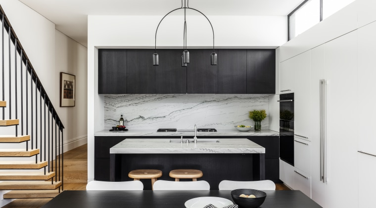 A modern kitchen in a modest-sized home, this white