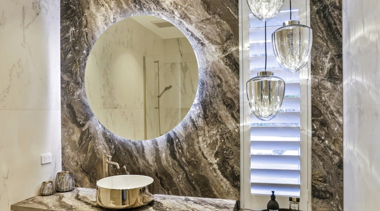 ​​​​​​​In this powder room, by Dunlop Design, the gray