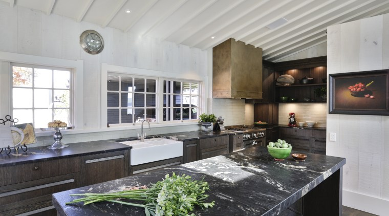 This kitchen is spacious and easy to use gray, black