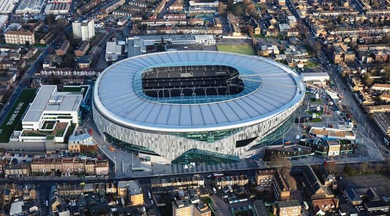 The new Tottenham Hotspur stadium offers diversification of aerial photography, architecture, arena, bird's-eye view, city, landscape, metropolitan area, soccer-specific stadium, sport venue, stadium, urban area, urban design, gray