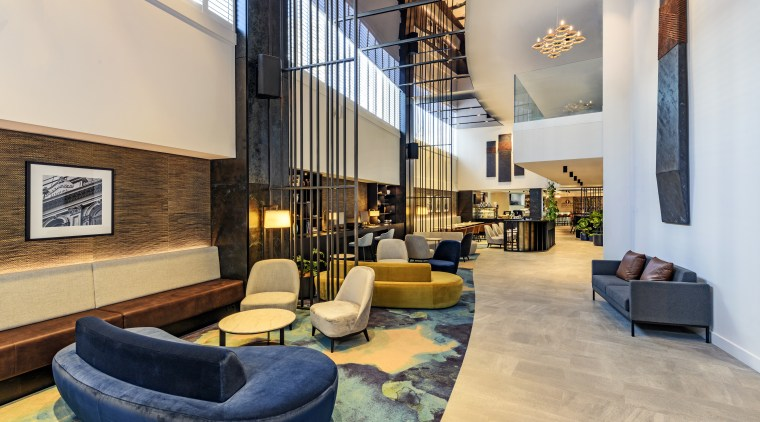 As project architects for Four Points by Sheraton architecture, building, ceiling, design, floor, flooring, furniture, home, house, interior design, living room, lobby, loft, property, real estate, room, waiting room, gray