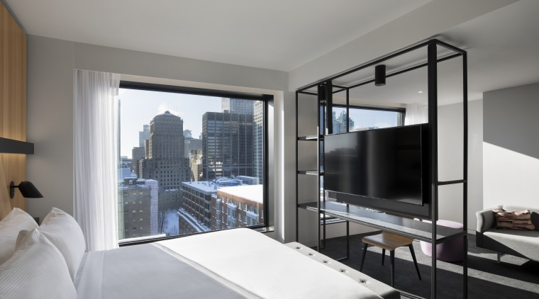 Highly contemporary, the Hotel Monville's bedrooms include floor-to-ceiling apartment, architecture, bed, bed frame, bedroom, boutique hotel, building, comfort, condominium, floor, furniture, house, interior design, living room, penthouse apartment, property, real estate, room, suite, gray