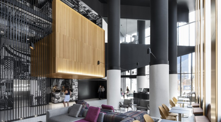 The scale of the giant columns in the apartment, architecture, building, ceiling, condominium, design, floor, furniture, home, house, interior design, living room, lobby, loft, property, real estate, room, black, gray