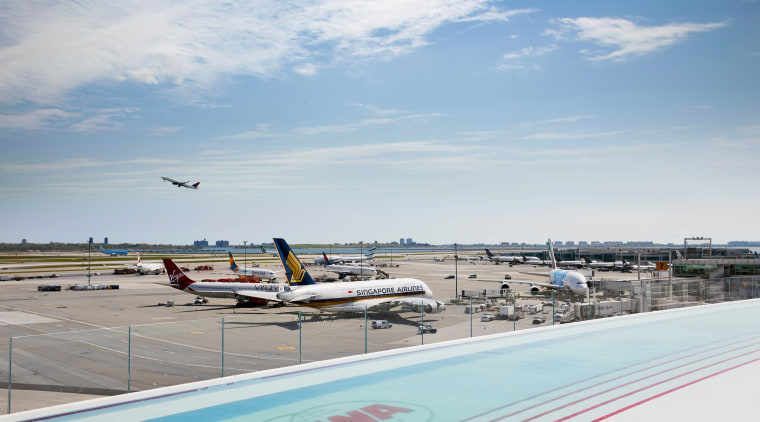 The TWA Hotel's rooftop infinity pool and observation aerospace engineering, air travel, aircraft, airline, airliner, airplane, airport, airport apron, aviation, flap, flight, general aviation, infrastructure, narrow-body aircraft, sky, vacation, vehicle, wing, gray