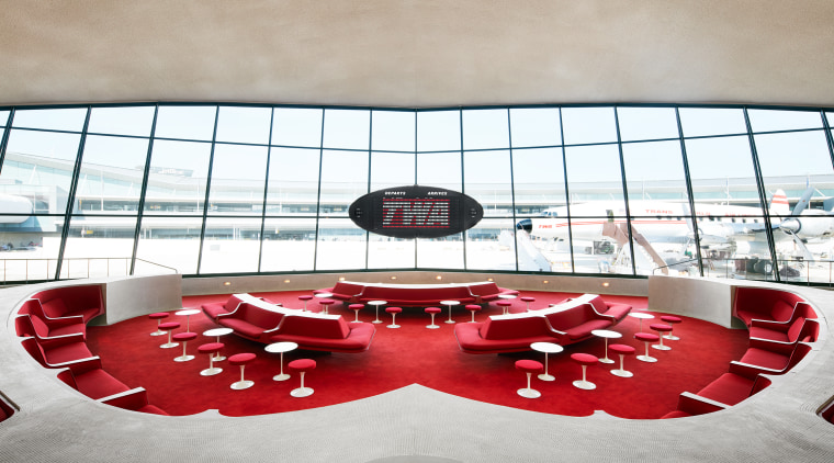​​​​​​​The Sunken Lounge at the TWA Hotel features architecture, building, design, interior design, red, room, table, gray