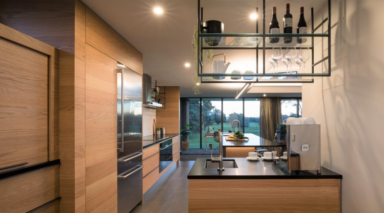 Extensive storage in this kitchen comes via a brown