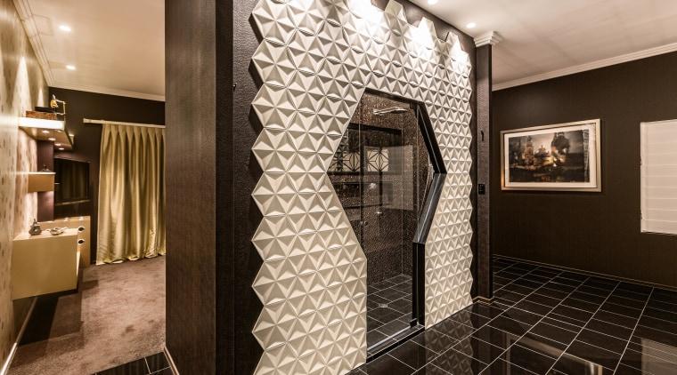 Black granite tiles in this bathroom zone continue black