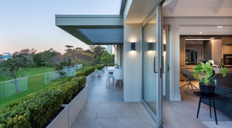 This lake-facing verandah with operable roof overlooks the