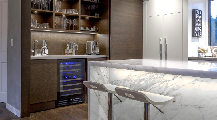 The beautiful appeal of marble and wood come architecture, bar stool, building, cabinetry, ceiling, countertop, floor, flooring, furniture, glass, home, house, interior design, kitchen, lighting, material property, property, real estate, room, shelf, table, gray
