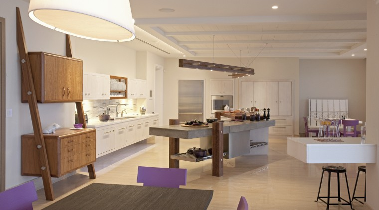 The cook(s) should have a view of the architecture, building, cabinetry, ceiling, countertop, design, dining room, floor, flooring, furniture, home, house, interior design, kitchen, lighting, living room, loft, material property, property, real estate, room, table, gray, brown