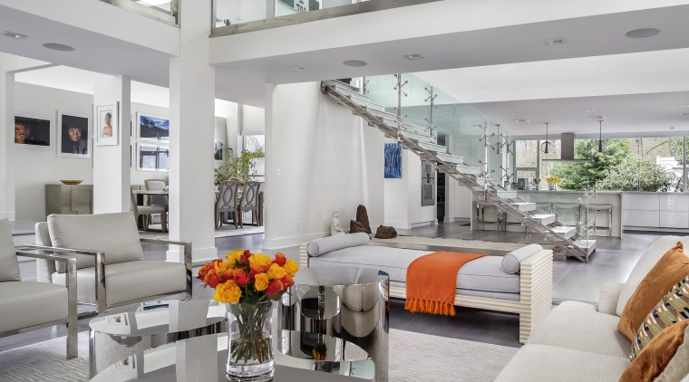 The central open staircase with glass balustrades is