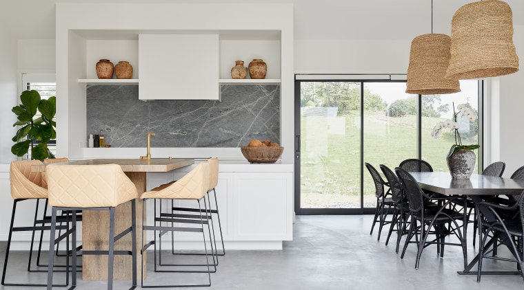 Light-toned concrete floors in the living areas are