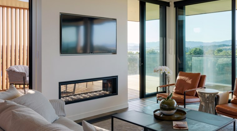 A see-through gas fireplace provides a warming feature