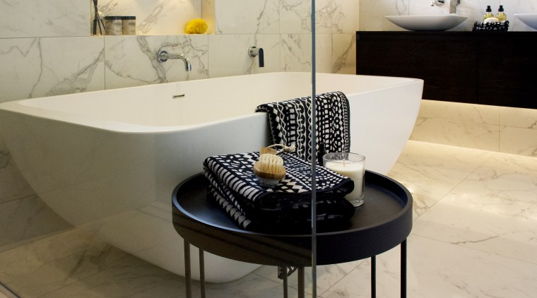 Marvel Calacatta tiles create continuity with the other architecture, bathroom, bathroom sink, black, black-and-white, bath tub, ceramic,  calacatta, tiles, design, floor, flooring, furniture, interior design, marble, material property, property, room, sink, table, tap, tile, gray