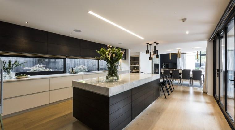Kitchen by Eterno Design countertop, interior design, kitchen, real estate, gray