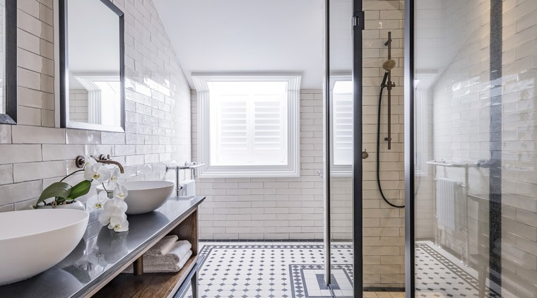 Black mirror frames connect with a black shower gray