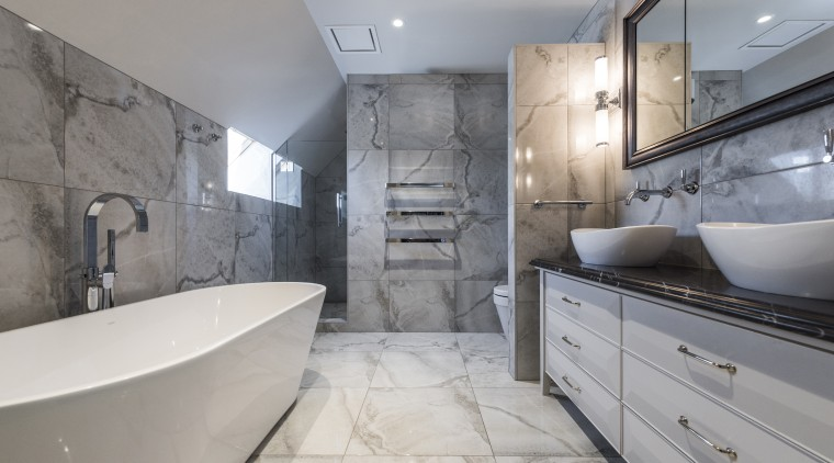 Limiting the designs materials and hues created a architecture, bathroom, bathtub, building, ceiling, estate, floor, flooring, furniture, home, house, interior design, plumbing fixture, property, real estate, room, tap, tile, wall, gray