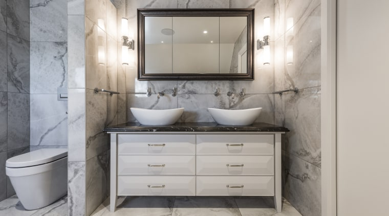 A gilded mirror adds another touch of refinement architecture, bathroom, bathroom accessory, bathroom cabinet, building, chest of drawers, drawer, floor, flooring, furniture, interior design, lighting, marble, material property, plumbing fixture, property, room, sink, tap, tile, gray