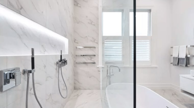 Marble-look tiles in a TIDA-award winning bathroom by bathroom, floor, home, interior design, property, room, tap, tile, white