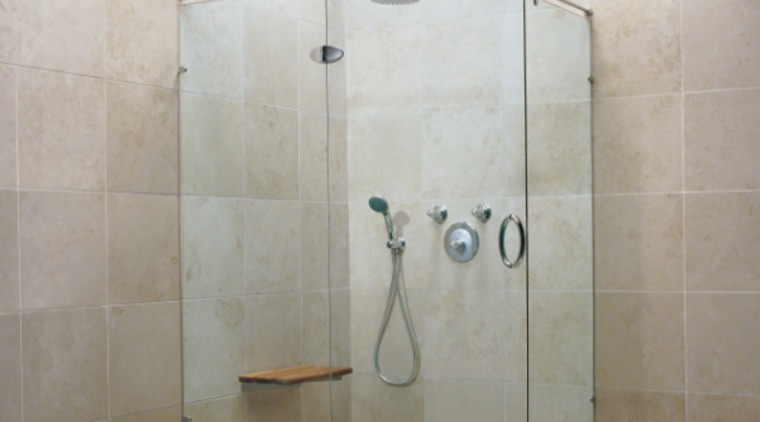 An example of a frameless glass shower. angle, bathroom, plumbing fixture, shower, tile, gray