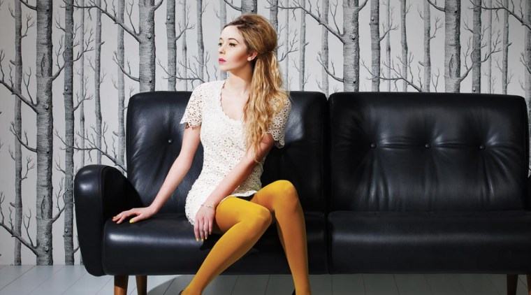Choosing the right upholstery fabric beauty, blond, clothing, couch, dress, fashion, fashion model, furniture, human leg, joint, lady, leg, long hair, model, photo shoot, photography, shoulder, sitting, thigh, black, gray