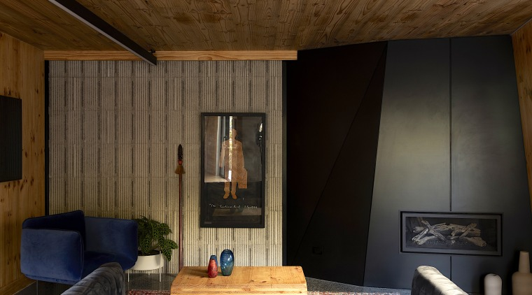 The interior features stark contrasts between warm and brown, black