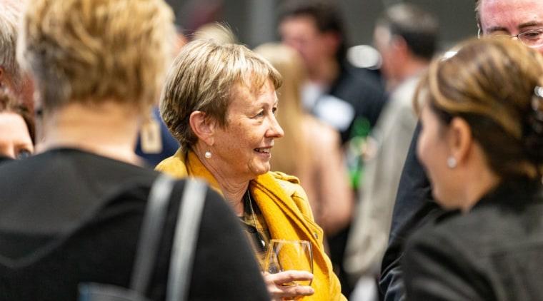 2019 TIDA New Zealand Homes presentation evening conversation, crowd, event, human, interaction, people, yellow, black