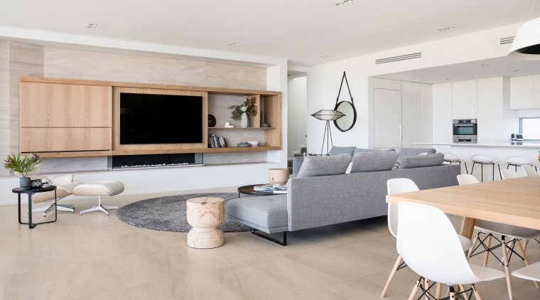 A Portuguese Limestone that has the grain and building, cabinetry, ceiling, coffee table, design, floor, flooring, furniture, home, house, interior design, laminate flooring, living room, property, real estate, room, table, tile, wall, wood flooring, gray