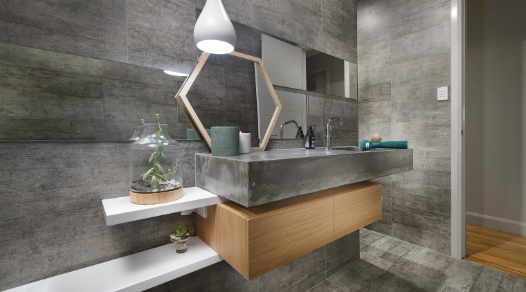 Strong, semi-industrial and minimalist, this family bathroom boasts architecture, bathroom, countertop, floor, flooring, interior design, sink, tile, gray
