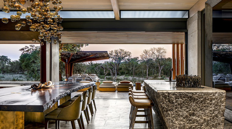 The open, seamless boundaries between interior and exterior architecture, backyard, building, ceiling, deck, dining room, estate, floor, furniture, home, house, interior design, landscaping, lighting, patio, porch, property, real estate, residential area, restaurant, roof, room, shade, table, tree, yard, brown, black